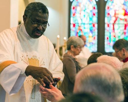 Reverend During Communion